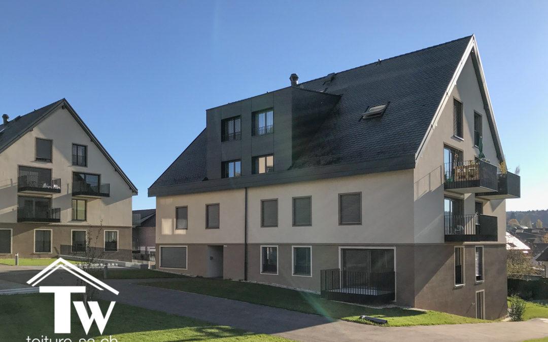 Couverture en tuile Gasser céramique anthracite sur 3 nouveaux immeubles à Froideville
